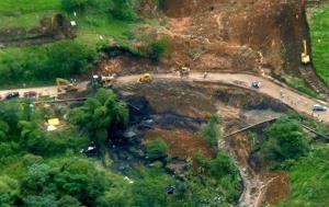 An aerial view of an oil spill caused when a landslide damaged a main pipeline of Ecuador's state oil company, near the volcano El Reventador, in Ecuador's Amazonian region, Friday, June 1, 2013.