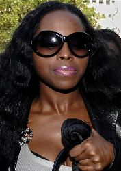 Rapper Foxy Brown, whose birth name is Inga Marchand, enters Manhattan criminal court, in this  Oct. 24, 2006, file photo, in New York.
