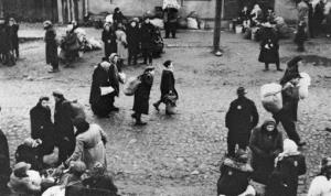 This October 26, 1943, photo show Jews gathered at an assembly point in the Kaunas ghetto in Kanuas, Lithuania for a deportation action, most likely to Estonia.