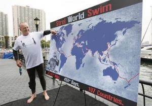 Martin Strel illustrates the route for his planned Strel World Swim at North Cove Marina in Manhattan yesterday.