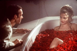 Lester Burnham (Kevin Spacey) is intrigued by Angela (Mena Suvari), sparking some major changes in his life in Dreamworks Pictures' American Beauty.