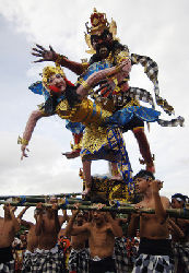 Balinese boys carry giant effigies of Ogoh-ogoh to ward off evil spirits on the eve of Nyepi or Hindu Day of Silence.