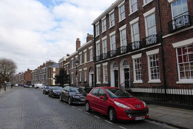 Woman and two children found dead in John Lennon's old Liverpool apartment