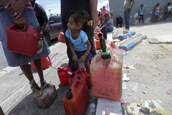 Puerto Ricans Still Waiting for Aid a Week After Maria's Devastation