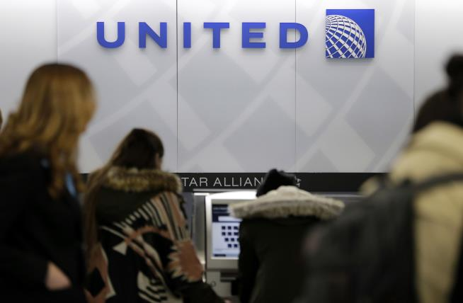 'Bumped' passenger gets $10000 travel voucher from United