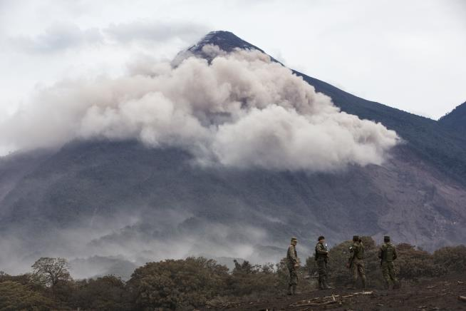 Rescuers search for missing near Guatemala volcano as death toll climbs