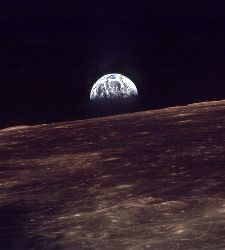 Earth rising above the surface of the Moon. Trace water found in volcanic moon rock is making scientists rethink much of what we know about the Moon.