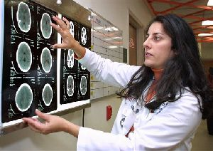 A doctor looks over a CT scan of a patient's brain.   New research suggests there are important anatomical differences between the brains of men and women.