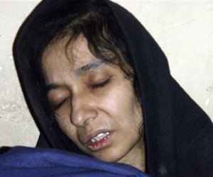 Aafia Siddiqui, whom police say a possible al-Qaeda associate, is seen in the custody of Counter Terrorism Department of Ghazni province in Ghazni City, Afghanistan, on Thursday, July 17, 2008.