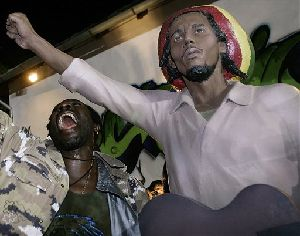 An unidentified Jamaican musician reacts the after unveiling of a statue of late Jamaican reggae legend Bob Marley in the Serbian village of Banatski Sokolac.