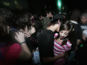 Teenagers dance and kiss at a nightclub in Santiago on August 1, 2008.