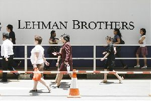 Neuberger Berman, the asset management arm of Lehman Brothers, will be sold to two private equity firms for $2.15 billion.