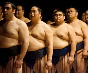 Grand sumo wrestlers line up for both the Japanese and United States national anthem at the Grand Sumo Tournament on Saturday, June 7, 2008, in Los Angeles.