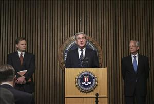FBI Director Robert Mueller is flanked by Ernie Allen, president of the National Center for Missing and Exploited Children, in this July 2008 file photo.