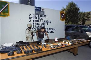 Luis Ramirez Vazquez, aka El Guero Camaron, member of the Arellano Felix drug cartel, right, is shown to media members in Tijuana, northern Mexico, Sunday, Oct. 26, 2008.