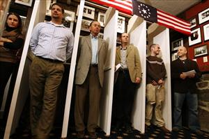 Dixville Notch residents wait for the stroke of midnight to be the first voters in the nation's presidential election early today.