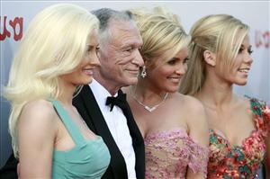 Holly Madison, from left, Hugh Hefner, Bridget Marquardt and Kendra Wilkinson in 2007.
