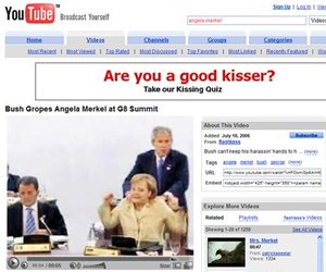 This screenshot from YouTube shows President Bush giving German Chancellor Angela Merkel an impromptu back rub.
