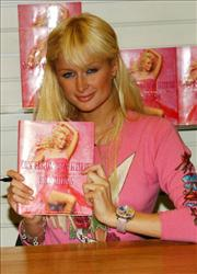 Paris Hilton signs copies of Confessions Of An Heiress.