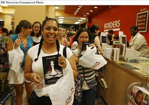 Fans of author Stephenie Meyer at Borders in New York City finally get their hands on some of the very first copies sold of Breaking Dawn just after midnight Sat., Aug. 2.