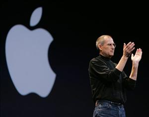 Apple Inc. CEO Steve Jobs applauds employees during his keynote address at a MacWorld conference in San Francisco.