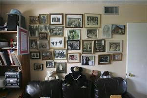 Family photographs hang on the wall of Herman and Roma Rosenblat's Florida home.