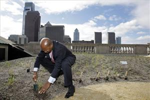 Mayor Michael Nutter places a plant on the roof of the Free Library of Philadelphia.
