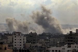 Smoke rises from an Israeli missile strike on a target in Gaza City, Tuesday, Dec. 30, 2008.
