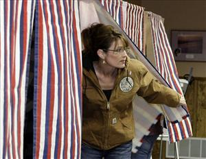 In this Nov. 4, 2008, file photo, Republican vice presidential candidate and Alaska Gov. Sarah Palin votes at Wasilla City Hall in Wasilla, Alaska.