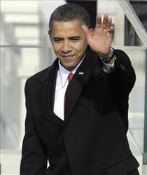 President Obama waves after he delivered his inaugural address at the US Capitol in Washington, Tuesday, Jan. 20, 2009.