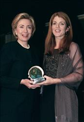 In this 1999 file photo, first lady Hillary Rodham Clinton receives the Arts Advocacy Award from Caroline Kennedy during the National Arts Awards.