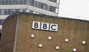 The BBC logo marks a a wall at the BBC headquarters in London.