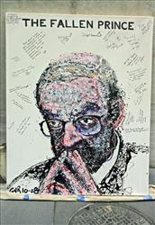 A portrait of Federal Reserve Chairman Alan Greenspan by artist Geoffrey Raymond is photographed outside the New York Stock Exchange,  Friday, Oct. 24, 2008 in New York.