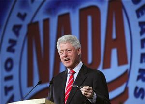 Former President Bill Clinton speaks to the National Automobile Dealers Association during their meeting in New Orleans  Monday, Jan. 26, 2009.