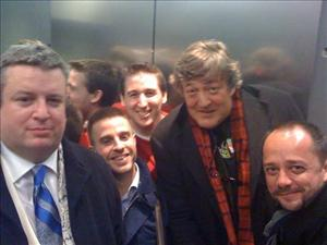 Actor John Frey (with scarf) peers out from broken elevator shortly after engineers appeared to free stuck passengers.