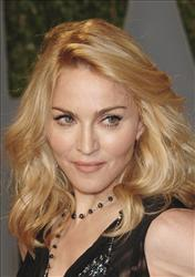 Madonna arrives at the Vanity Fair Oscar party Sunday in West Hollywood, Calif.