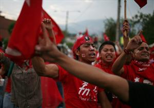 Supporters of the Farabundo Marti National Liberation Front party (FMLN) cheer for their candidate Mauricio Funes, who won El Salvador's presidential election yesterday.