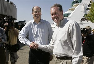 Brian P. McAndrews, left, CEO of aQuantive, shakes hands with Microsoft's Kevin Johnson as they mug for media members at the completion of a brief news conference, Friday, May 18, 2007, in Seattle. Microsoft Corp. said it will buy online advertising firm aQuantive Inc. for about $6 billion in cash,...