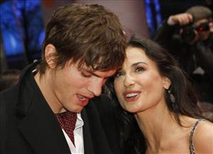Demi Moore arrives with her  husband Ashton Kutcher for the premiere of the competition movie Happy Tears at the Berlinale in Berlin, on Wednesday, Feb. 11, 2009.