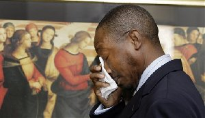 Attorney Clarence Roby Jr., wipes his eyes after New Orleans City Council member Oliver Thomas spoke at a press conference and announced his resignation in New Orleans Monday, Aug. 13, 2007. Thomas pled guilty to one count of federal felony bribery. (AP Photo/Alex Brandon)