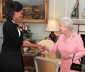 Michelle Obama greets the queen. This light handshake is fine, say etiquette experts. Beyond that, the queen is hands off.