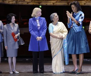 Chikako Aso, wife of Japan's Taro Aso, Laureen Harper, wife of Canadian PM Stephen Harper, and Gursharan Kaur, wife of Manmohan Singh of India visit the Royal Opera House with Michelle Obama.