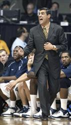 In this Nov. 17, 2008 file photo, Villanova coach Jay Wright reacts to an official's call as his team plays Fordham in the first half of an NCAA college basketball game  in Villanova, Pa.