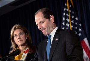 New York Gov. Eliot Spitzer announces his resignation as his wife Silda Wall Spitzer stands next to him March 12, 2008.