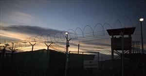 The sun rises over Guantanamo detention facility, at the US naval base in Guantanamo Bay, Cuba, Nov. 19, 2008.