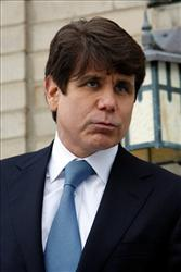 Impeached Illinois Gov. Rod Blagojevich talks to media as he arrives at his home, Thursday, Jan. 29, 2009 in Chicago.