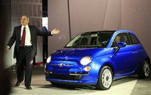 Jim Press, president and vice chairman of Chrysler, steps out of a Fiat 500 at the 2009 New York International Auto Show on April 8.