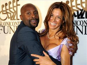 Pro Football Hall of Famer Jerry Rice hugs Kelly Bensimon as they arrive for the annual Great Sports Legends Dinner last year in New York.