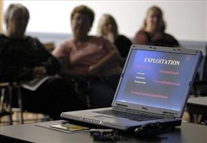 Parents listen to a cybercrimes seminar conducted by Connecticut State Police.