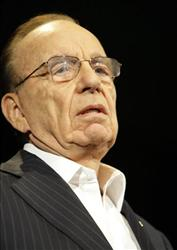 Rupert Murdoch, chairman and CEO of News Corporation, said he expects his newspapers to begin charging for online access within a year.